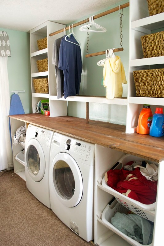 Built-in Laundry Unit with Shelving, Seesaws and Sawhorses on Remodelaholic.com