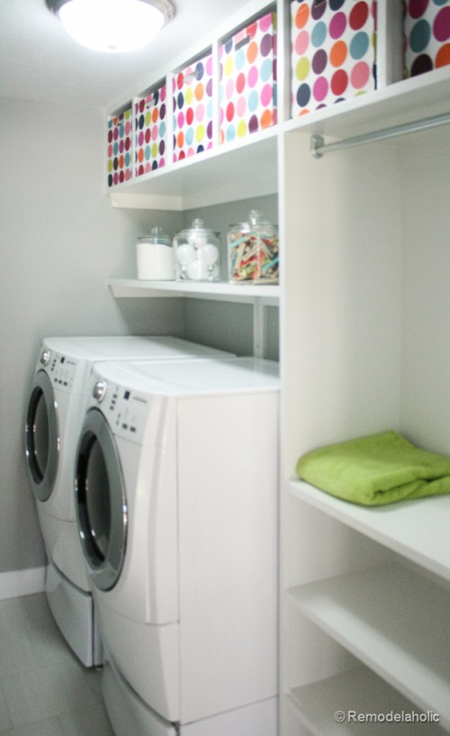 Colorful bins for organizing items on the top shelf. Fabulous Laundry room design ideas from @Remodelaholic