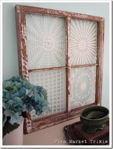 Flea Market Trixie - old window with vintage doilies - via Remodelaholic