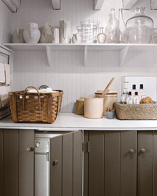 Hidden Laundry open storage featured on remodelaholic.com