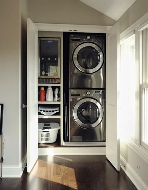 Laundry in a closet compact but well designed featured on Remodelaholic.com