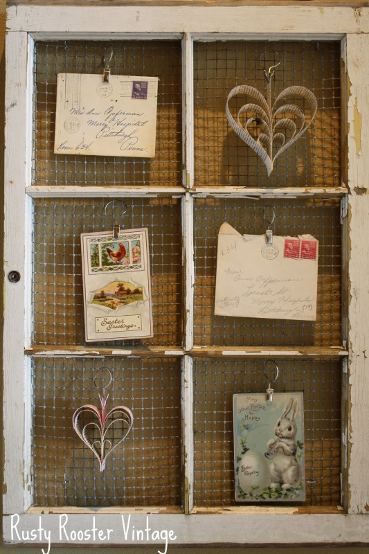 Rusty Rooster Vintage - old paned window with hardware cloth as photo display or memo board - via Remodelaholic