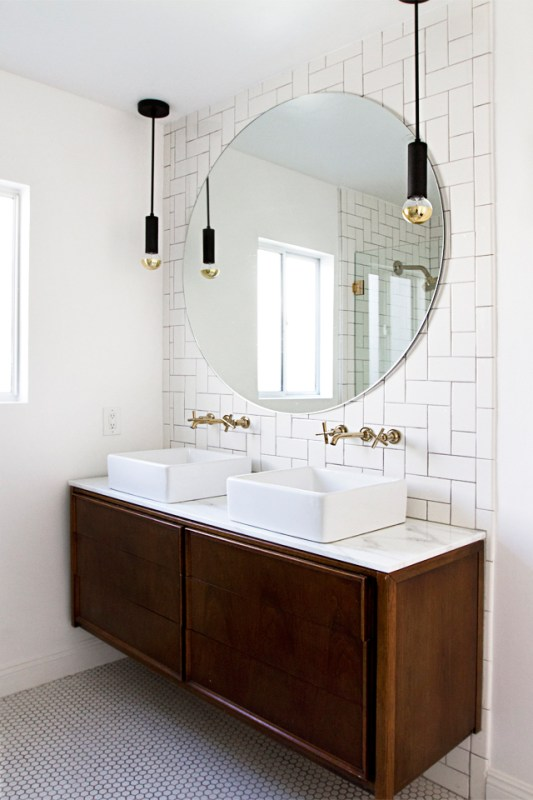 Decorating with White @Remodelaholic - white bath with vintage wood credenza vanity