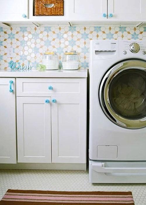 great tile backsplash over laundry