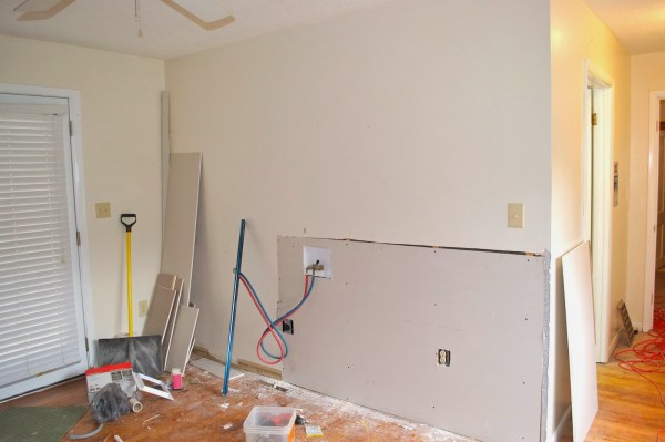 installing washer and dryer hookups, Seesaws and Sawhorses on Remodelaholic
