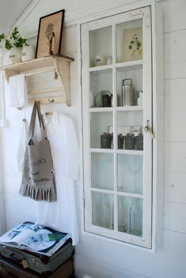 source unknown - paned window into shallow wall cabinet - via Remodelaholic