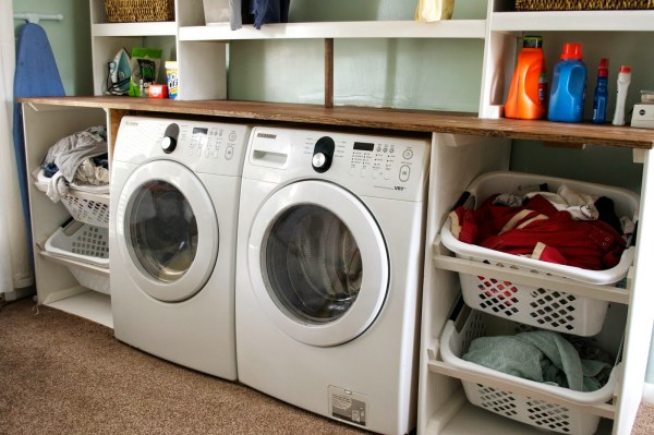 tilted laundry basket storage in laundry unit, Seesaws and Sawhorses on Remodelaholic