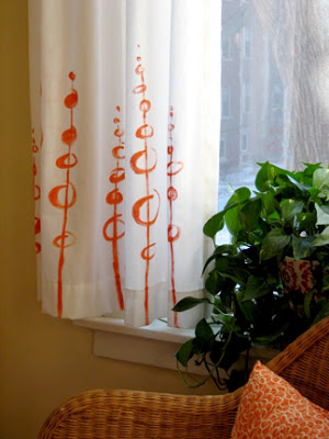 How About Orange - hand painted freehand curtains - via Remodelaholic