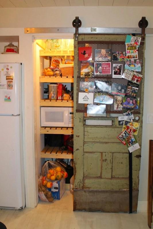 pantry storage on wood slat shelves with sliding barn door, Girl Meets Carpenter on @Remodelaholic