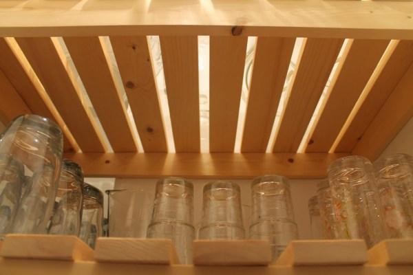 underneath view of wood slat pantry shelving, Girl Meets Carpenter on @Remodelaholic
