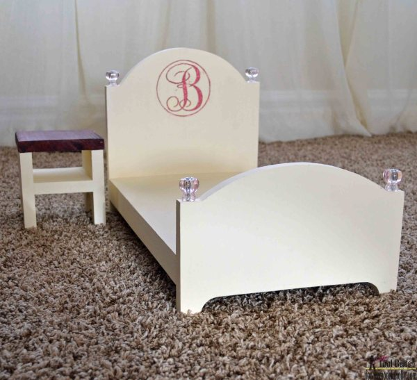 Build a DIY elegant doll bed and bonus nightstand.  All you need is a board, jig saw, hammer and nails - so easy and around $13.