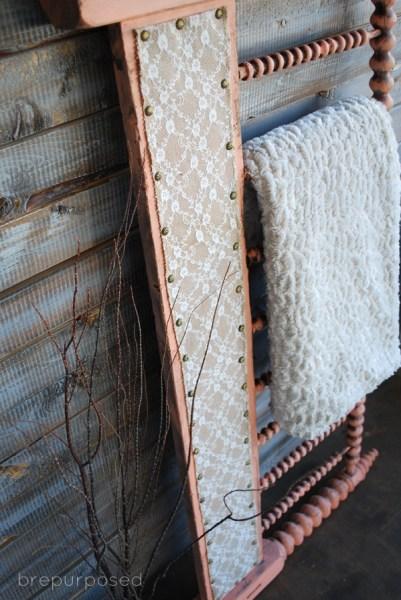 headboard turned quilt rack - Brepurposed via @Remodelaholic