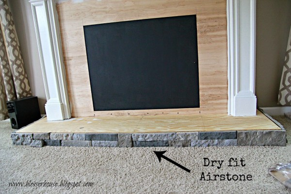 airstone on faux fireplace - Blesser House featured on @Remodelaholic