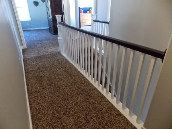 banister after replacing spindles and building newel post around existing - TDA Decorating and Design featured on @Remodelaholic