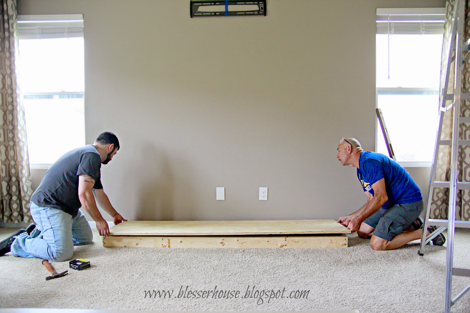 Remodelaholic how to build a faux fireplace and mantel building the hearth base for faux fireplace blesser house featured on remodelaholic solutioingenieria Gallery