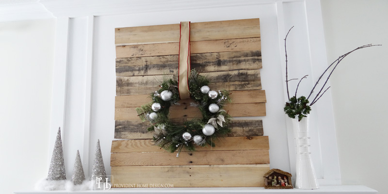 christmas mantel with chimneypiece woodwork above fireplace - Provident Home Design featured on @Remodelaholic