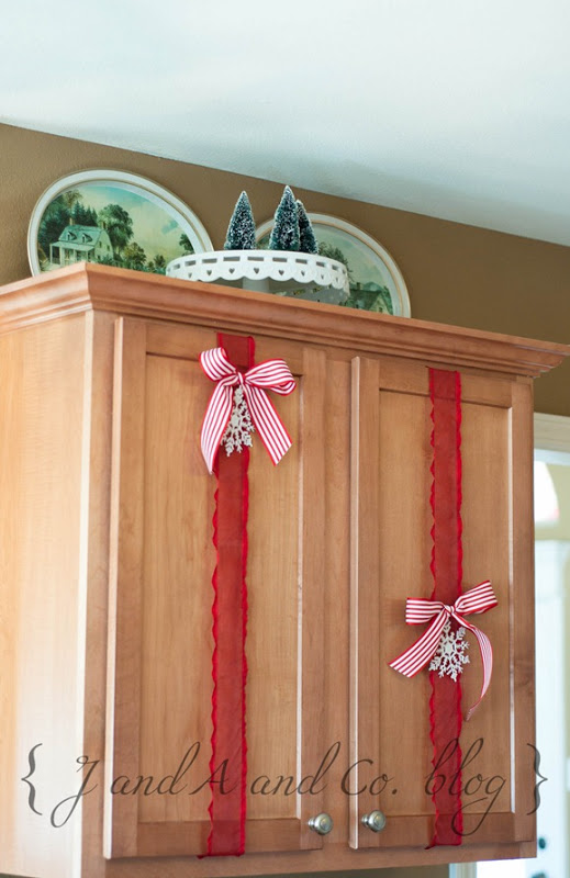 easy Christmas decor for kitchen cabinets - J and A and Co via @Remodelaholic