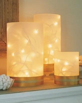 easy twinkling vase luminaries - Martha Stewart via @Remodelaholic