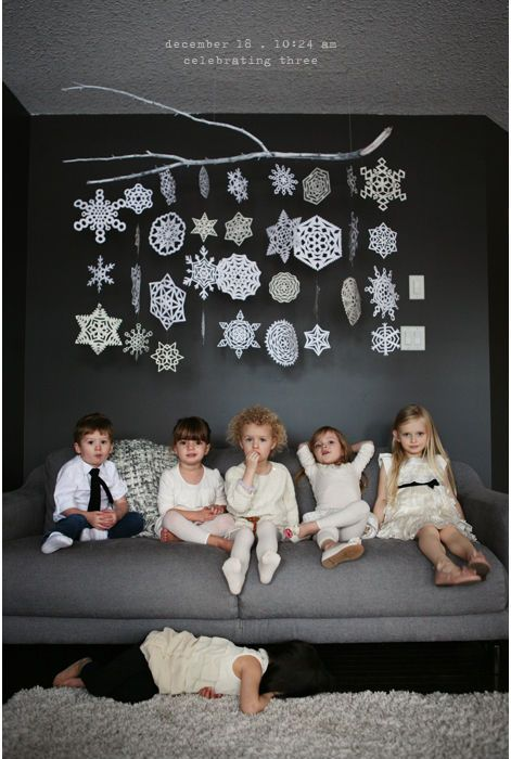 hanging paper snowflakes from a branch for a winter mobile art - Lila Was Here via @Remodelaholic