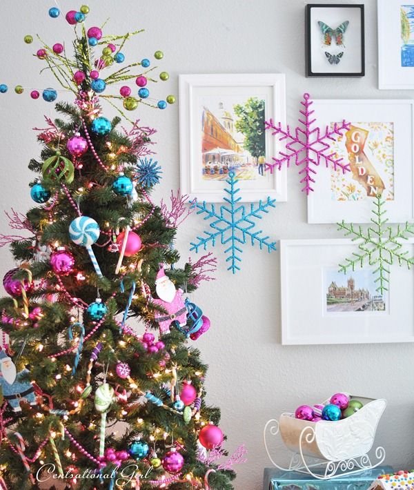 large snowflake ornaments on gallery wall - Centsational Girl via @Remodelaholic