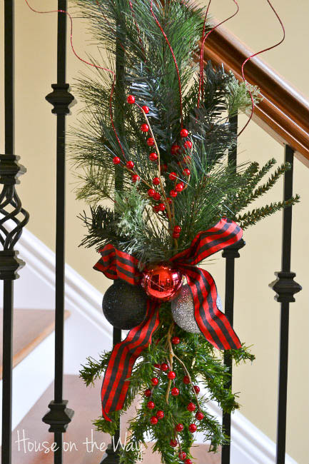 make a fresh pine Christmas swag for the stairs - House on the Way via @Remodelaholic