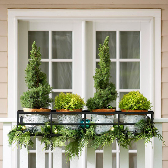 mini Christmas trees in outdoor planter window boxes - BHG via @Remodelaholic