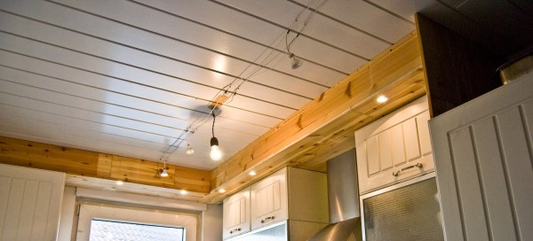 over-cabinet lighting in a tiny kitchen - Pudel-design featured on @Remodelaholic