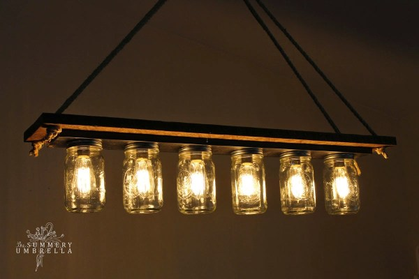 rustic wood mason jar chandelier tutorial - The Summery Umbrella featured on @Remodelaholic