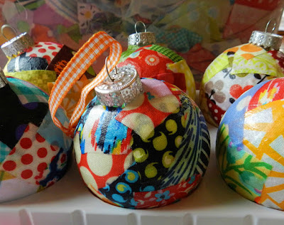 Fabric Covered Ornaments - Try these 35+ DIY ideas for clear glass ornaments to add precious memories and lots of spirit to your Christmas tree! from @tipsaholic #ornaments #diy #christmas