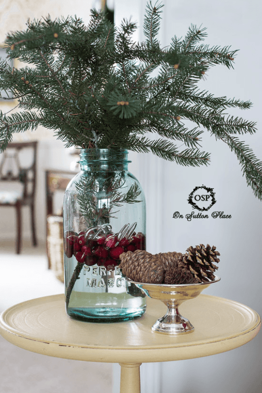 use fresh greens and cranberries to create a winter vignette - On Sutton Place via @Remodelaholic