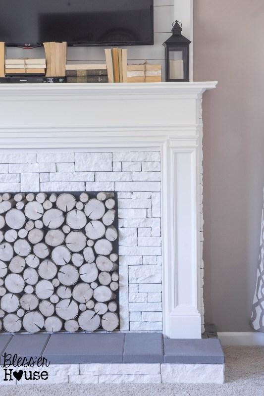 white airstone and concrete faux fireplace tutorial - Blesser House featured on @Remodelaholic