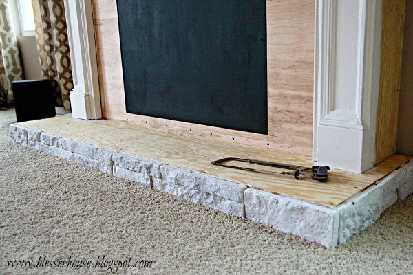 whitewashed airstone on DIY faux fireplace - Blesser House featured on @Remodelaholic