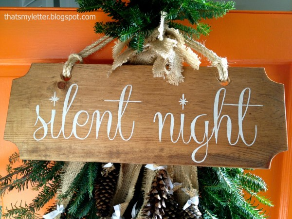 wood gift tag door decor with fresh pine swag - That's My Letter via @Remodelaholic