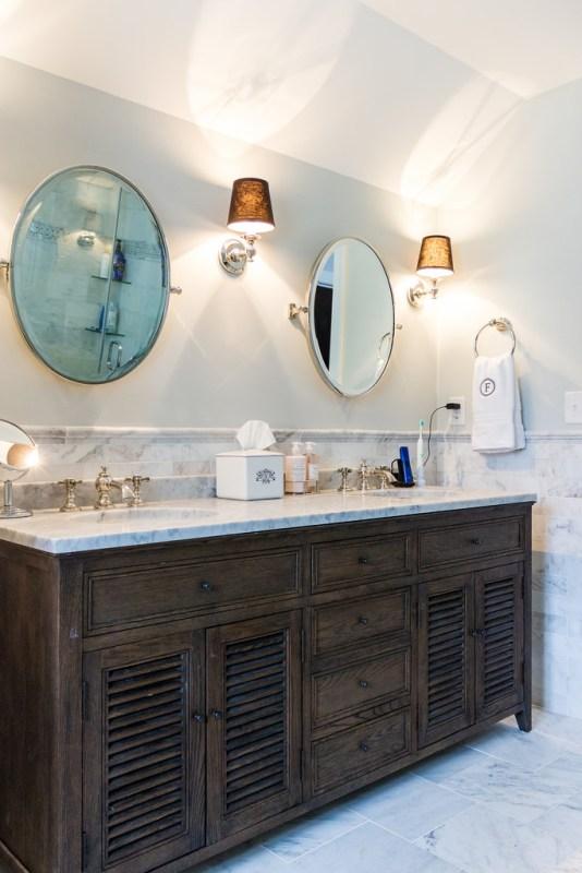 (Coventry) dark wood double vanity with marble top in large bathroom, painted in Stonington Gray by Benjamin Moore @Remodelaholic