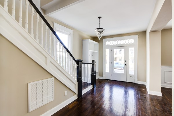 Inviting entryway with dark walnut floors and built-in storage (Griffin) @Remodelaholic