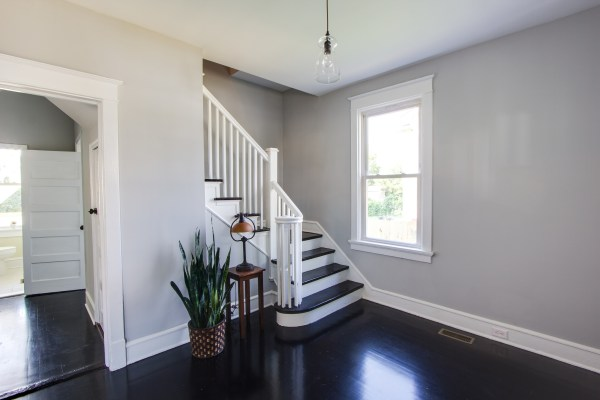 Inviting entryway with dark wood floors - Fendall @Remodelaholic