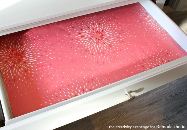 Use clear contact paper over wrapping paper to make drawer liners. Remodelaholic