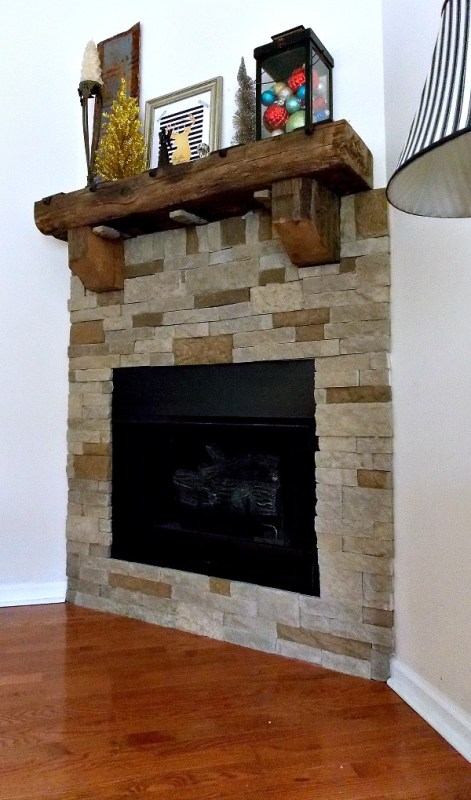 airstone fireplace with rustic mantel - Sweet Parrish Place via @Remodelaholic