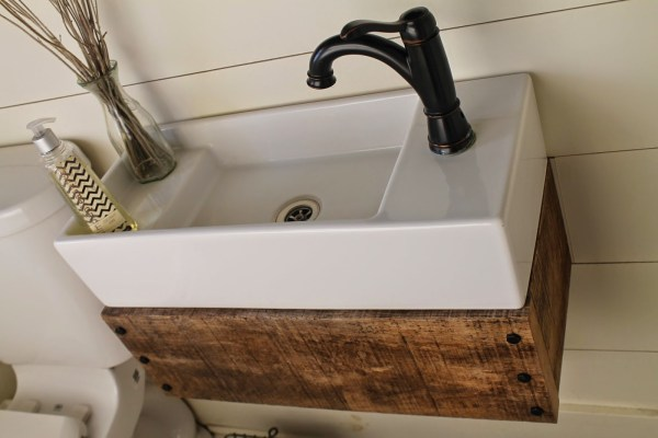 build a wood floating vanity to fit an IKEA sink - Girl Meets Carpenter featured on @Remodelaholic