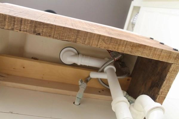 diy reclaimed wood floating vanity - Girl Meets Carpenter featured on @Remodelaholic