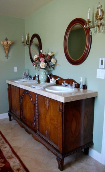 elegant master bath remodel with vintage sideboard vanity - Saltbox Treasures via @Remodelaholic