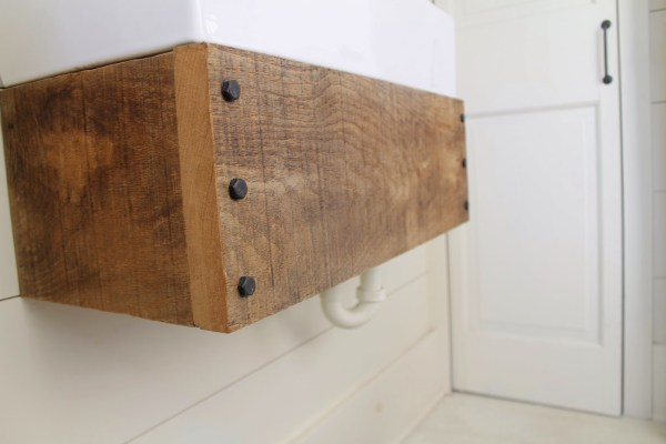 use reclaimed wood to make an easy floating bathroom vanity - Girl Meets Carpenter featured on @Remodelaholic