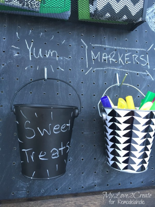 So smart! A chalkboard pegboard command center. Versatile and easy for organizing the family!