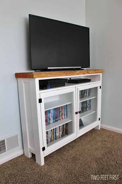 Custom TV Console with Old Windows for Doors by Two Feet First featured on @Remodelaholic