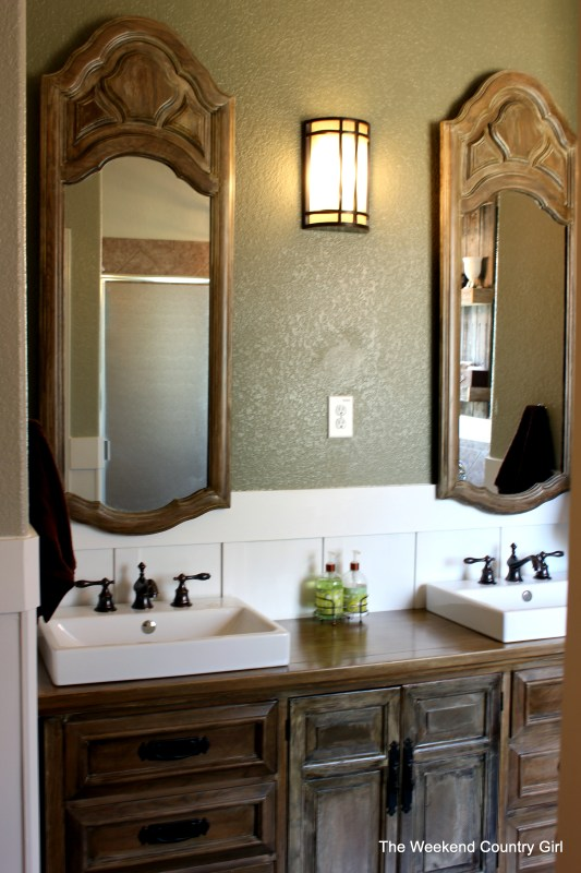 Dresser turned vanity for a bathroom makeover by The Weekend Country Girl featured on @Remodelaholic