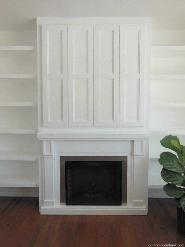 Hidden TV in Built In Fireplace by Our Home Notebook featured on Remodelaholic