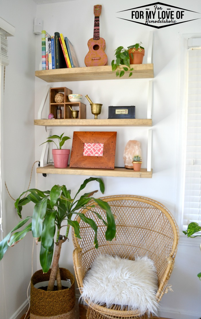 Taking an unusued corner and making it a place to display decor and house an additional seat for the living room