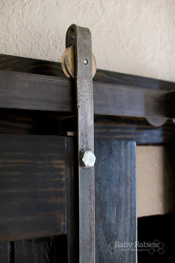 ... Diy Barn Door Rolling Hardware On A Black Barn Door   Baby Rabies