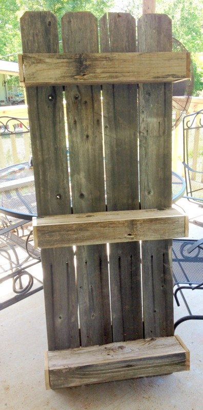 rustic wall shelf for the bathroom, built from fencing The Weekend Country Girl on @Remodelaholic