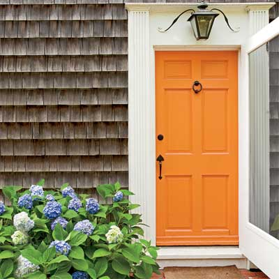 Beautiful Doors - entry door in orange Sherwin-Williams Navel